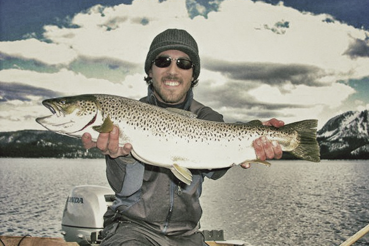 James and his brown trout on a secret lake